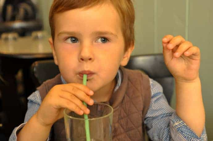 Child drinking water at Greedy tea room, Bordeaux